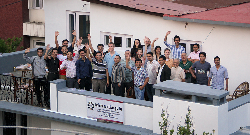 Image of KLL team on balcony of new headquarters